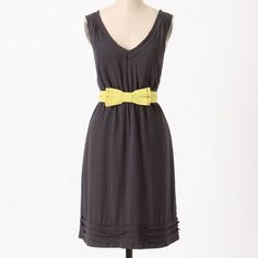 Lovely navy dress with chartreuse belt by Maeve Pretty sleeveless navy dress with raw edge ruffles at neckline and hem, elastic waist, pockets, and a chartreuse bow waist belt. Fully lined with lace detail at lining hem. Anthropologie Dresses