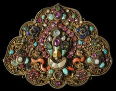 Gilded Metal Pendant set with Semi-Precious Stones Nepal 19th century