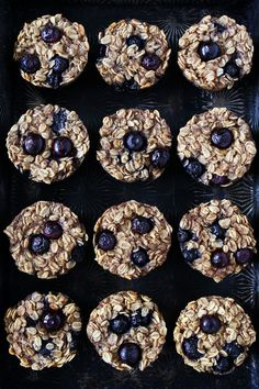 Banana Blueberry Baked Oatmeal Cups Recipe on twopeasandtheirpod.com These easy baked banana blueberry oatmeal cups are vegan and gluten-free! They are perfect for breakfast on the go, school lunches, or snack time!