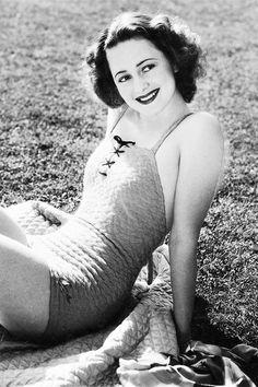 Olivia de Havilland photographed by Scotty Welbourne
