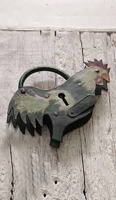 coqurel padlock - Plümo Ltd. this is great for looks, though it probably won't keep out the rural thieves around here. two keys supplied. £25