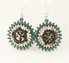 """Made in U.S.A Style # 5004K Size 1.65"""" x 1.5"""" Kinetic Gear Earring 5004K All Gears Move! Comes as shown - Teal/Natural Wood/Black Satin Made from sustainably sourced materials Laser-cut wood Stained with water based dye Ear wires are silver-finished 3041 stainless steel with new electrophoretic-coating that resists tarnishing"""