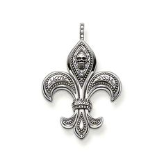 "THOMAS SABO ""fleur-de-lis"" pendant with eyelet made from blackened 925 Sterling Silver. The Bourbon lily (French = ""fleur de lis"") symbolises purity and power. The skull makes this a rebellious item of jewellery made from blackened 925 Sterling Silver (Size: 4.4 cm)."