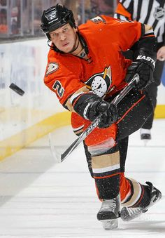 Kevin Bieksa #2 of the Anaheim Ducks dumps the puck during the game against the Pittsburgh Penguins