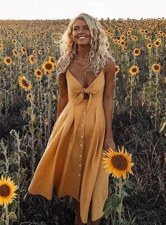 The sun sink over the sunflower fields. Elise Cook wearing a sunshine dress which makes her look awesome.