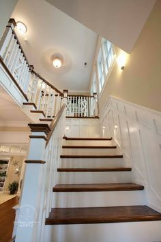 Wood and white stairs staircase stairway, wood stained treads, white risers, trim work millwork in white, great details via Blue River Cottage