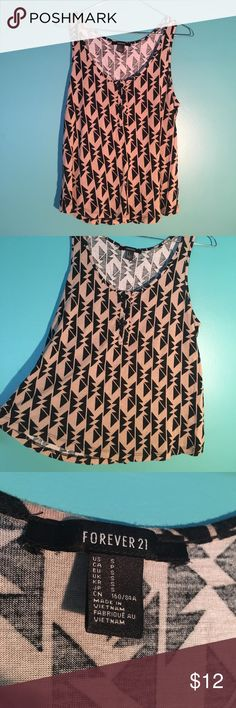 Tribal Print Loose Fit Tank with Buttons Tan and black tribal print tank. Loose fit with buttons on the collar. Soft & in very good condition. Forever 21 Tops Tank Tops