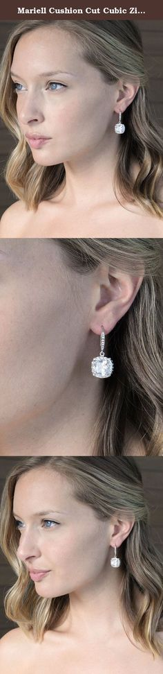 Mariell Cushion Cut Cubic Zirconia Wedding, Bridal CZ Earrings in Rhodium with Pave Frame & Euro Wire. Ready to make a sparkling statement? All eyes will be on you flaunting these exclusive Mariell earrings with gleaming cushion cut center stones and pave CZ halos. With AAAAA grade zircon gems and luxurious genuine Platinum plating, these gorgeous silver drop earrings will jazz up any occasion. We love the dress up or dress down versatility of these square-shaped dangles. Whether walking...