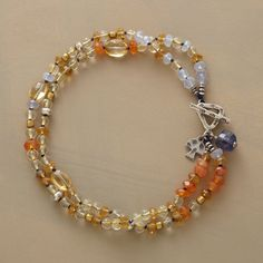 "SUNSHINE TO GO BRACELET -- Two sparkling, sunny strands of citrine and carnelian beads are punctuated with a single iolite cube. Sterling toggle closure. Handcrafted exclusively for Sundance. 7-1/2""L."