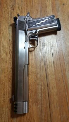My AMT Hardballer Longslide. Just put the chrome grips on. I was going to get chrome grip screws but I didn't want it to look gaudy; -)