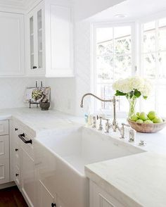 A gorgeous farmhouse sink is paired with an antique polished nickel faucet mounted in front of a bay window to a honed white marble countertop accenting white cabinets adorning oil rubbed bronze hardware. - My Interior Design Ideas Kitchen Cabinets Decor, Cabinet Decor, Cabinet Ideas, Oak Cabinets, Cabinet Makeover, Kitchen Walls, Kitchen Hardware, Antique Cabinets, Cabinet Drawers
