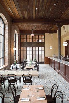 this restaurant is beautiful | mosaic tiles | exposed brick | exposed ceiling beams