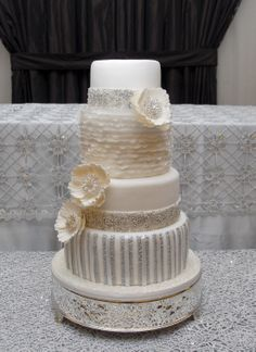 Elegant wedding cake with masculine stripes and feminine ruffles a perfect match!