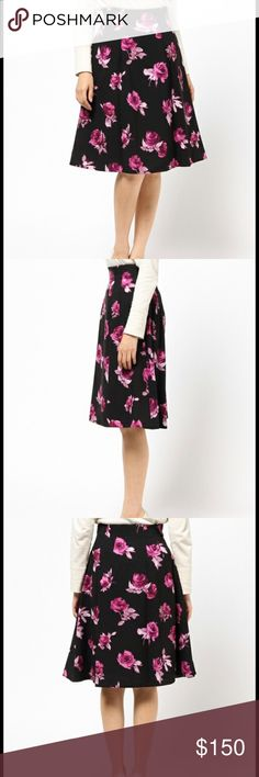 Kate Spade Encore Rose Midi Skirt On Pointe featuring a dramatic floral design that's meant to recall the roses tossed on stage at the end of a show, this flattering skirt is a show-stopper. try it with anything from a simple tank to a silky bow-tied blouse.  Shell: 90% Polyester  10% Elastane  Lining: 100% Polyester   * High Waisted, Knee Length  * 26 1/4 inches  from top to bottom *Dry Clean Only kate spade Skirts Midi