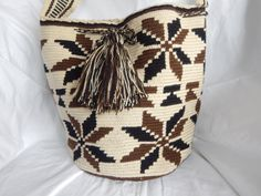 This mochila is made of cotton in a crochet style weave. Its ideal for the beach, the parks and running errands. It is an excellent gift to