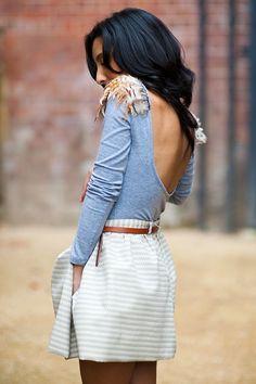 deep cut v back embellished shirt with belted high waisted skirt.