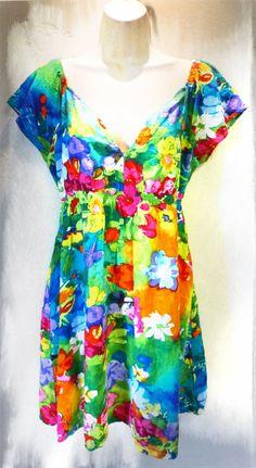 Vintage 1990s Watercolor Babydoll Mini Dress Jams World Large Rayon Spring Hawaiian Tropical Resort Short Shirt Plunging Pockets Colorful. $23.00, via Etsy.