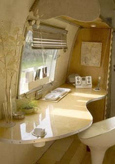 very cool inside to an airstream...dream of mine to have one and create a perfect tiny, mobile space...