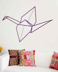 Washi Tape Origami Crane Wall Art | Martha Stewart Living - Make a bold visual statement with this origami crane. For maximum effect, place the crane on an empty wall with little furniture. For a more subtle look, scale it down in size or use a color that creates a low contrast when against the wall.