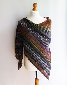 This top down shawl uses two different coloured balls of Debbie Bliss Rialto Luxury Sock yarn. Starting with a garter tab cast on, striped garter stitch sections seperate a simple eyelet pattern.