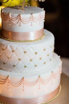 This Disneyland wedding cake is pretty in blush.