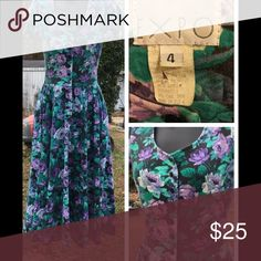 """Vtg 80s Button Floral Dress! Super Cute! Purple & Teal on Black Floral Print, tshirt-like material, No buttons are missing. Has small shoulders pads. Really great condition. Colors are vibrant, no fading. No holes. Pockets.  Measures:  overall L 42"""". 26""""W(no give), skirt 29""""' chest 32"""" Expo Dresses Midi"""