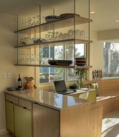 Ceiling suspended shelf - Kitchen Storage - love the easy access and open sight lines