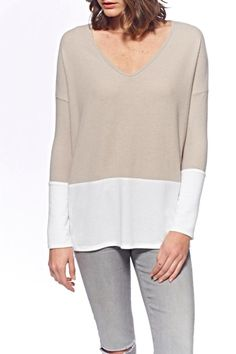 A loose fit, light-weight long sleeve featuring a white bottom trim and a v neck. Super-soft fabric.   Color Blocked Top by Mickey & Jenny. Clothing - Tops - Long Sleeve Clothing - Tops - Blouses & Shirts Clothing - Tops - Casual Florida