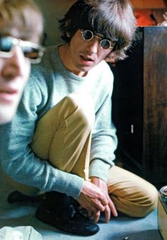 George Harrison in the Presidential Suite of the Tokyo Hilton (with John Lennon in the foreground), June 1966, by Robert Whitaker