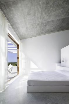 Concrete ceiling and floor with white walls