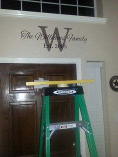 "Family Establish Sign Over Front Door.  ""W"" Is Painted In A Brown Color 12 Inches Tall.  The ""The Williams Family"" Is 6 Inches Tall.  ""Est. 2005"" Is 6 Inches Tall.  Here's Where I Got The Idea From: https://www.etsy.com/listing/155207782/family-name-vinyl-wall-decal-established?ref=sr_gallery_7&ga_search_query=family+established+decal&ga_view_type=gallery&ga_ship_to=US&ga_page=4&ga_search_type=all"
