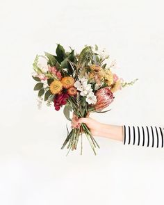These spring time flowers are giving us a spring in our step. The perfect wedding bouquet idea. #weddingbouquets