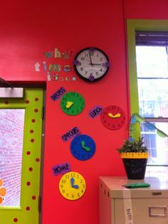 paper clocks showing times of periods of the day (lunch, recess, dismissal, specials)
