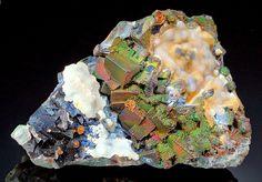 Unique Specimen of Iridescent Limonite over Fluorite with Chalcedony - Okorusu Mine, Otjiwarongo District, Otjozondjupa Region, Namibia (Source: exceptionalminerals.com)