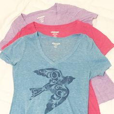 "Set of 3 Cotton Tees - Size Small Set of 3 great v neck cotton ""vintage"" style (comfortable, classic) tees. Pink and purple have no design. Blue has cute navy blue lark screen print. Pink and purple like new! Blue has gentle wear. Great deal! Tops Tees - Short Sleeve"
