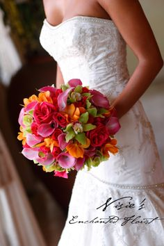 Nisie's Enchanted, This exquisite bouquet favors the tropical color scheme. With pink roses and calle lilies, lime green cymbidium orchids, with accent of orange mokara orchids this bouquet is a spectacular mixture of bright colors.