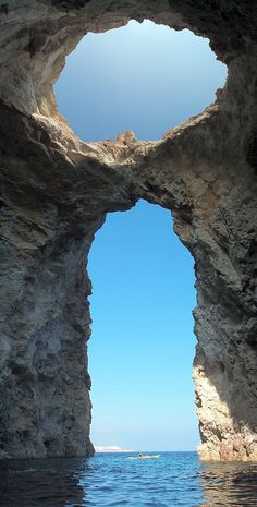 taken on the north side of the island of Poliegos, about 10 kilometers east of Milos. This formation is known as Macry Cave.
