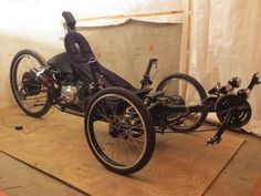 Scratch-built, fully-suspended  Tadpole trike, with hybrid 49cc Honda-clone Lifan motor with electric start, and 500watt (? - maybe higher) electric hub motor.   Make mine a 125cc Lifan motor with electric start, please.