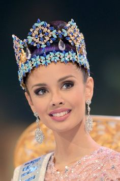 Miss World 2013 Megan Young wearing the Miss World crown which is nicknamed the Blue Crown for its vivid colors, turquoise features and blue stones. It is made up of diamonds, sapphires and turquoises mounted on a gold frame