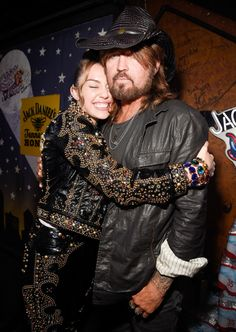 "DADDY'S GIRL_Miley hug dad Billy Ray Cyrus at a celebration for her new album ""Younger Now"" , in Nashville."