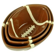 """Set out your favorite morsels with this 3-piece ceramic nesting bowl set. The football motif is the perfect accompaniment to your game day favorites.   Product: Small, medium and large bowlConstruction Material: CeramicColor: Brown and whiteDimensions: Small:  1.75"""" H x 4.25"""" W x 3"""" D  Medium:  2"""" H x 5"""" W x 3.5"""" DLarge:  2.25"""" H x 5.75"""" W x 4"""" D"""