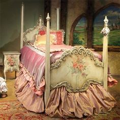 Antique painted bed with vintage pink linens
