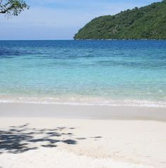 Escape to Malfini Beach, just a short boat ride away from Labadee.