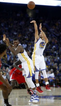 Golden State Warriors' Stephen Curry hits a 3-pointer as Festus Ezeli is fouled in 2nd quarter while playing Los Angeles Clippers during NBA game at Oracle Arena in Oakland, Calif., on Wednesday, November 4, 2015. Photo: Scott Strazzante, The Chronicle