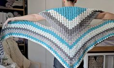 When I got my hands on some of the originalCaron Cakes, I knew the first thing I wanted to do was a triangle shawl. To make this pattern a bit more inter