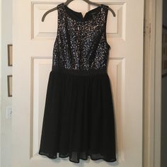 Black sequined party dress Fits above knees. Black and silver sequins on top. Black chiffon like on skirt. Only worn once! Forever 21 Dresses Midi
