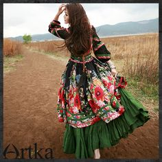 Mongolian dress...cute style for traditional folk,ethnic ,gypsy,boho and lagenlook lovers with pretty pattern of flowers and poppies replicate it by putting coloured frilled maxi skirt or petticoat under a calf length pattern dress with lots of bangles ,necklaces and mexican tapestry belts to accessorize
