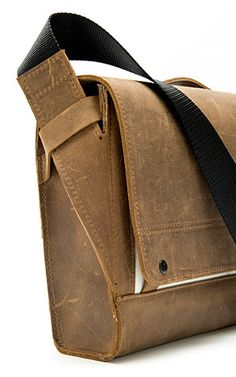 The Rough Rider is made for today's urban wrangler, transporting digital devices and documents in sturdy, long-lasting leather. A unique shoulder strap system keeps the contents snug Backpack Bags, Leather Backpack, Leather Bags, Leather Shoulder Bag, Shoulder Strap, Leather Projects, Leather Design, Leather Accessories, Leather Working