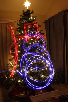 Continuing my light trail photos.  I drew a snowman with red and blue LED lights.