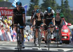 Richie Porte (C) of Australia and Team Sky arrives at the finish line with teammates Geraint Thomas (L) of Great Britain and Team Sky and Mikel Nieve Ituralde (R) of Spain and Team Sky during the thirteenth stage of the 2014 Tour de France, a 197km stage between Saint-Etienne and Chamrousse, on July 18, 2014 in Chamrousse, France. (Photo by Doug Pensinger/Getty Images)